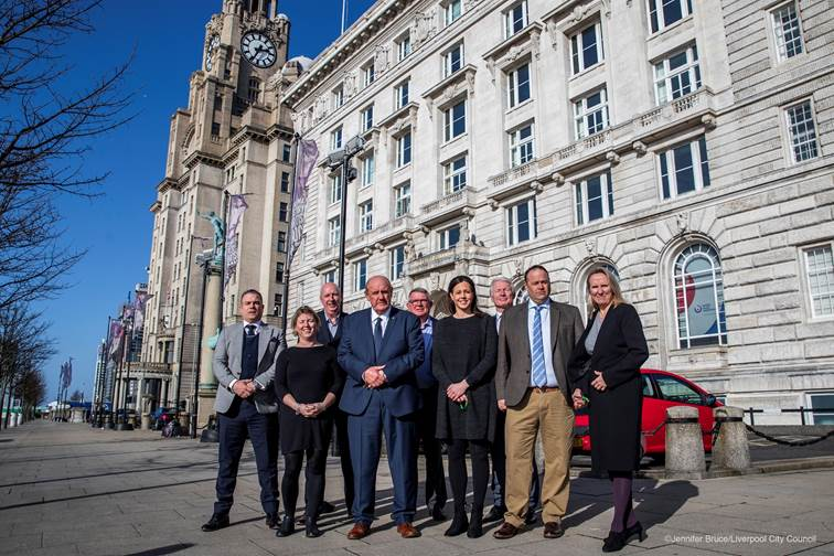 The Sport Liverpool Board standing outside of Liverpool's Three Graces